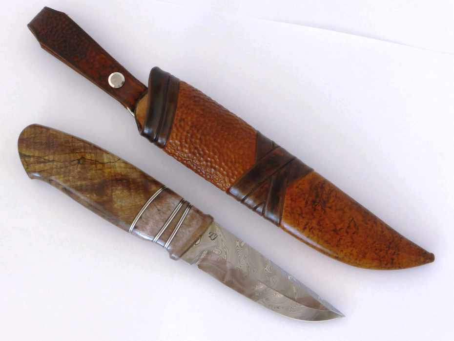 blade in Damasteel grinded by Tommy Jimmefors. handle in dyed and stabilized moose antler, stabilized spalted maple and pewter spacers.