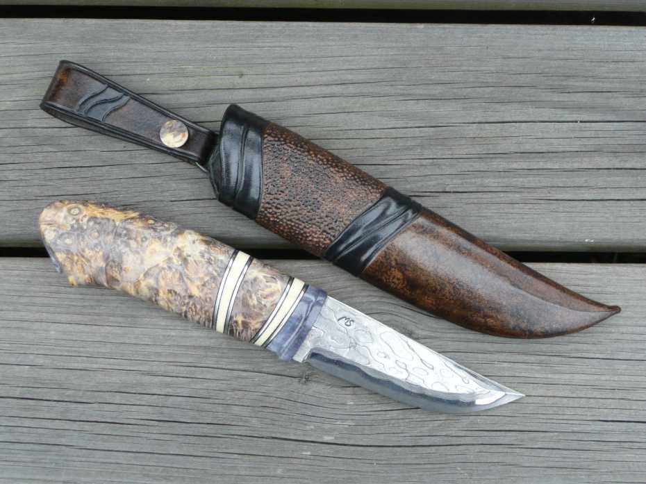 Damascus blade forged by Mattias Styrefors, handle in dyed and stab. moose antler, mammoth tusk, pewter spacers and stab. box elder.
