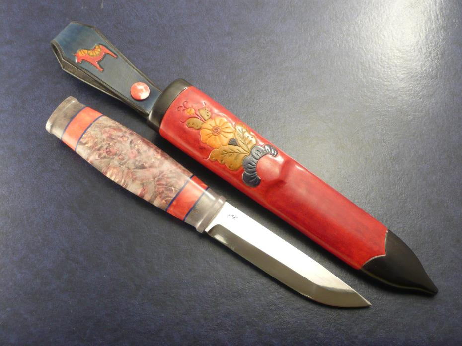 a Moraknife in dyed elk horn and stab. box elder.