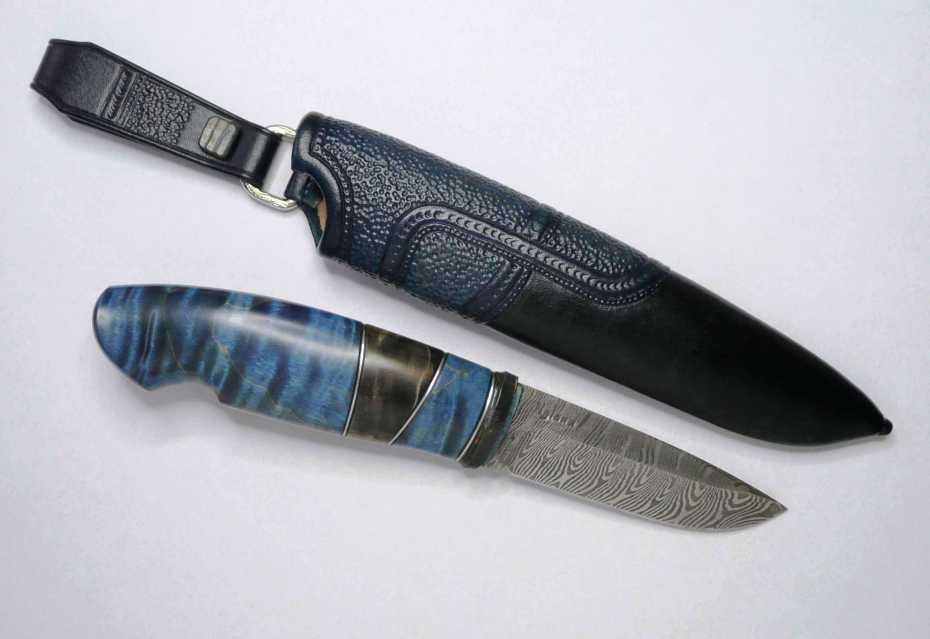 handforged blade by the Nylunds Brothers, handle in mamoth, stab. birch burl, tin spacers and stab. maple.