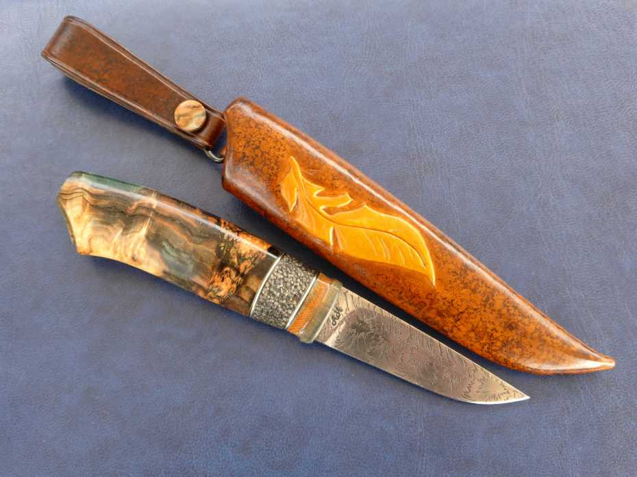 Damascus bar by Mattias Styrefors, grinded by Anders Hedlund. handle in mammoth tusk, buffalo antler and dyed and stabilized aspen burl